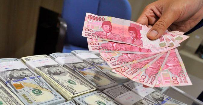 Rupiah Terpuruk pada Rp 14.725 di PasarSpot